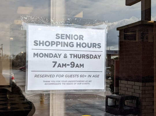 Signs are posted on the doors of United on Old Iowa Park Road showing senior shopping hours Mondays and Thursdays 7 - 9 a.m. amend COVID-19.