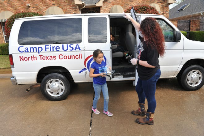 Camp Fire youth, Sophie Dell'Aquila, 7, left, and summer camp director Anastasia Green delivered Meals on Wheels, Thursday as part of Absolutely Incredible Kids Day. Camp Fire started their after-school program Sept. 8, and offers pickup from the child's school.