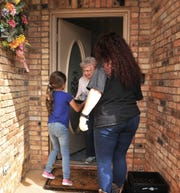 Camp Fire youth, Sophie Dell'Aquila, 7, left, and summer camp director Anastasia Green delivered Meals on Wheels, Thursday as part of Absolutely Incredible Kids Day.