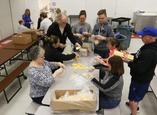 Volunteers assemble sandwich contents at Zanesville Middle School on Thursday. Zanesville City Schools will distribute food at their schools from 10 a.m. to 1 p.m. today. In addition, food will be distributed at Zanesville Metropolitan Housing locations, and Veterans Park at the corner of Ontario St. and Moxahala Avenue. The district is encouraging drive-up pick-up to minimize contact. There will also be a box available to for students to drop off completed work.