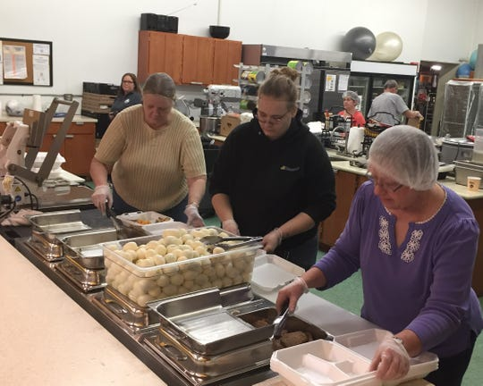 Volunteers prepare to-go meals at Christ's Table Thursday morning in preparation for the 11 a.m. pickup time. In 2019, the Hunger Network served more than 782,000 meals. That number is expected to drastically increase as many residents are finding themselves without income during the coronavirus crisis.