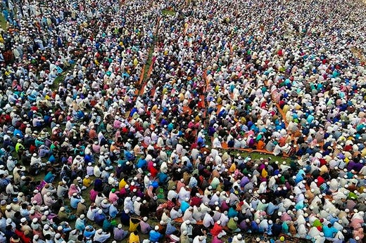 Thousands of Muslims attend a prayer session asking for safety amid concerns over the spread of the COVID-19 novel coronavirus, near Raipur in Lakshmipur district on March 18, 2020.Thousands of Muslims have joined a special prayer in a southern Bangladesh town seeking protection from the coronavirus to almighty, officials said on March 18 as the south Asian nation confirmed its first casualty by Covid-19.