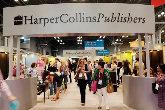 This May 28, 2015 file photo shows attendees at the HarperCollins Publishers booth during BookExpo America in New York.