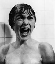 "Janet Leigh screams for her life in the infamous shower scene from Alfred Hitchcock's ""Psycho."""