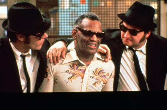 "Ray Charles (center) cameos alongside Dan Aykroyd and John Belushi in ""The Blues Brothers."""