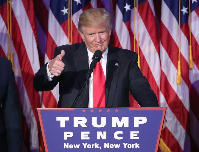 Donald Trump gives a thumbs-up to the crowd during his acceptance speech at his Election Night event at the New York Hilton Midtown in the early morning hours of November 9, 2016, in New York City.