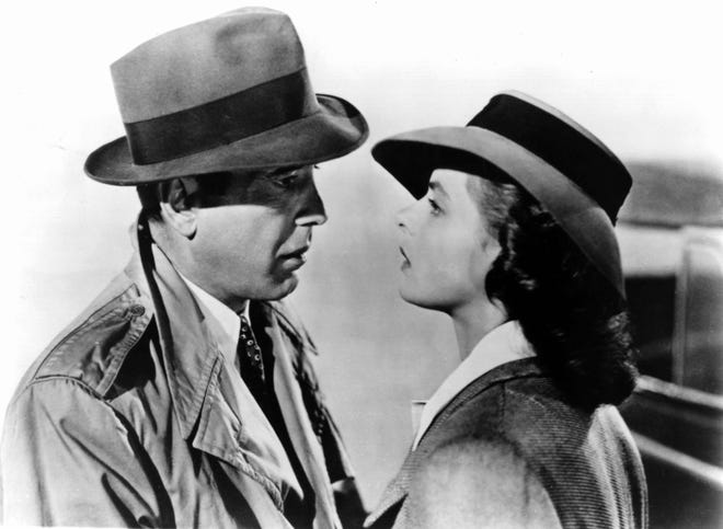 """Humphrey Bogart (left) and Ingrid Bergman play former lovers in a complicated situation in """"Casablanca."""""""