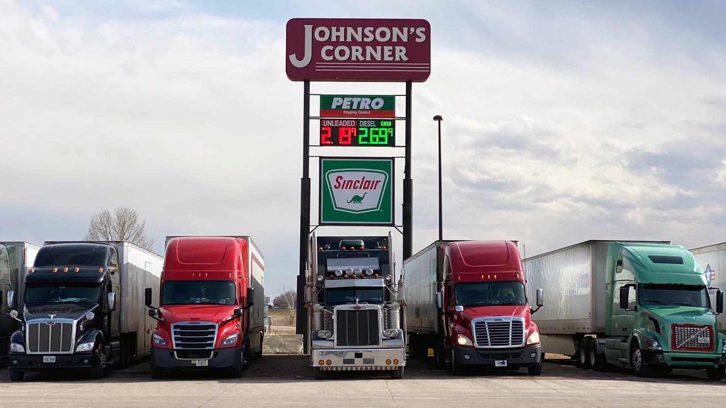 Truckers brave coronavirus outbreak to deliver goods: