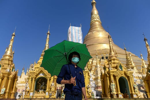 A man wears a face mask, amid concerns of the spread of the COVID-19 coronavirus, as he visits Shwedagon Pagoda in Yangon on March 18, 2020.