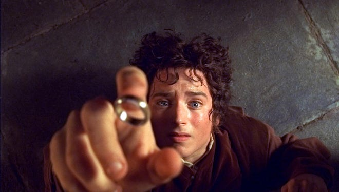 """Frodo (Elijah Wood) begins a journey to rid the world of the One Ring in """"The Lord of the Rings: The Fellowship of the Ring."""""""