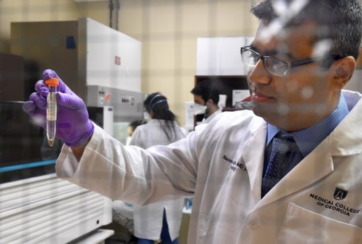 Director of the Georgia Esoteric & Molecular Laboratory (GEM) Dr. Ravindra Kohle holds a vial containing a possible coronavirus sample before it is tested at the GEM lab at the Medical College of Georgia in Augusta, Ga., Thursday morning March 19, 2020.