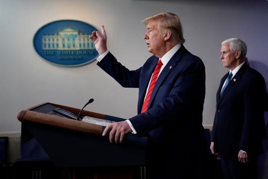 President Donald Trump speaks during press briefing with the coronavirus task force, at the White House, Thursday, March 19, 2020, in Washington. Vice President Mike Pence listens at right.