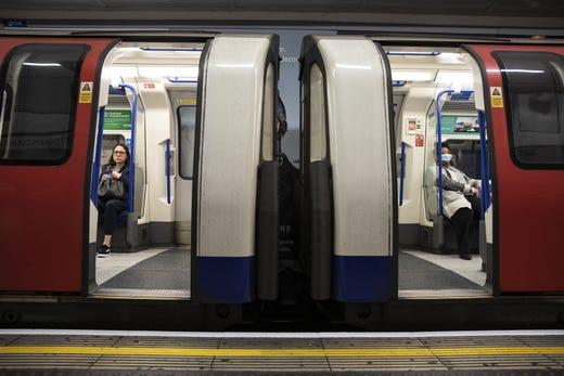 Passengers ride the tube on March 19, 2020 in London, England. Transport for London announced the closure of up to 40 stations as officials advised against non-essential travel. Bus and London Overground service will also be reduced.