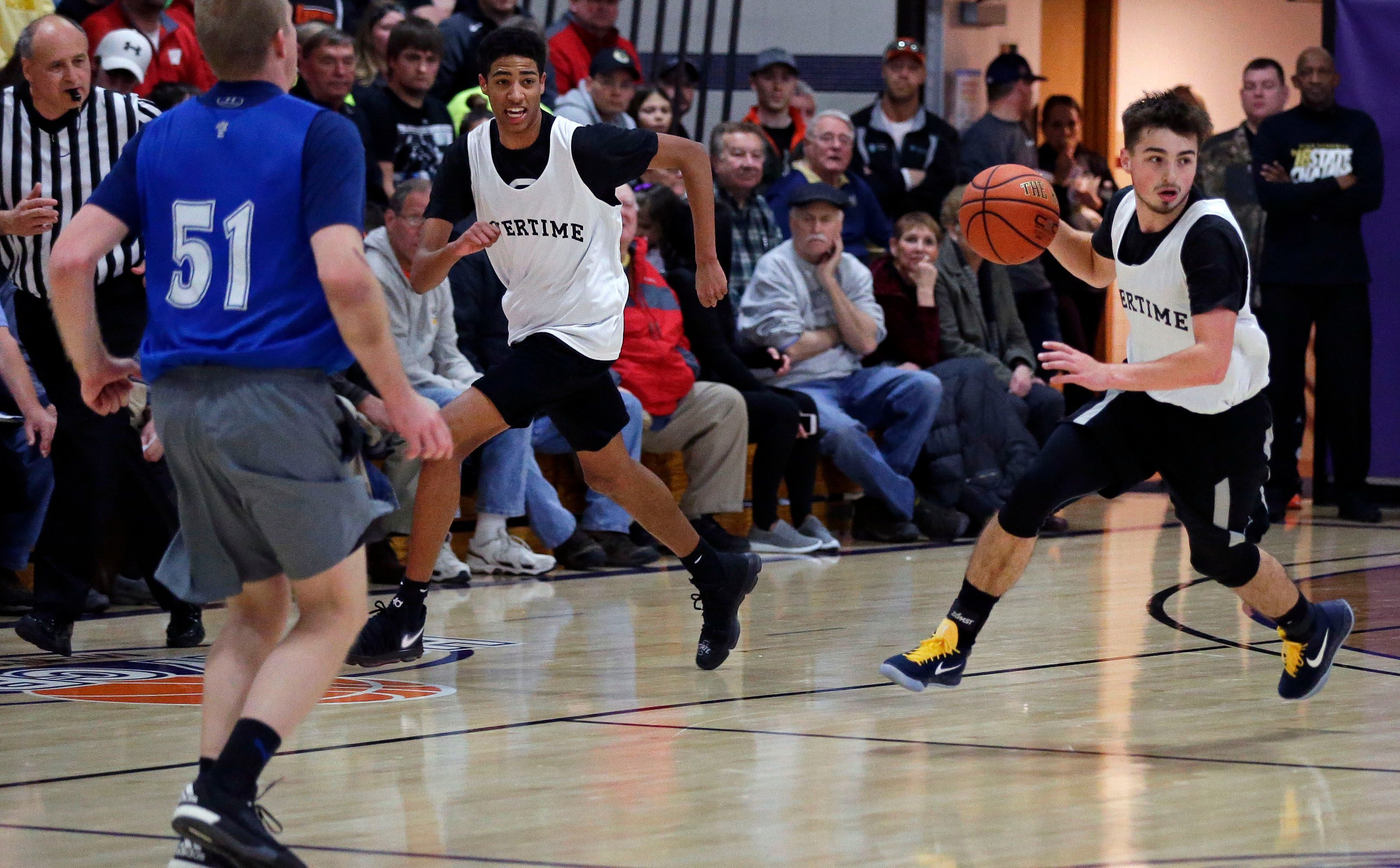 Jordan McCabe, right, of Kaukauna and Tyrese Haliburton of Oshkosh North competed for Overtime Sports in the Holy Cross Men's Open basketball tournament in 2018.