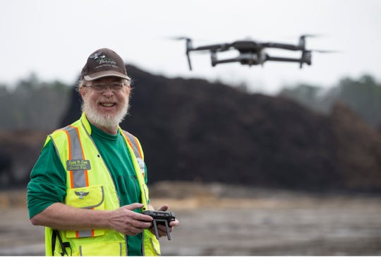 All Is Sharp Photography, a full-service photographic business based in Farmingdale, will be celebrating its 30th anniversary this April. Owner Joe Sharp is shown at Adventure Crossing where he has been capturing drone footage of the construction process. 