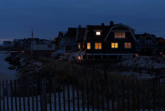 Houses along East Avenue in Bay Head are lit as the sun sets to the west. 