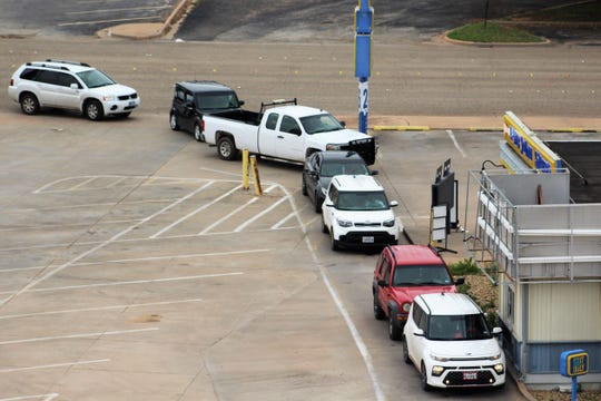 Vehicles were backed into the street at Long John Silver's restaurant in Abilene, using the drive-thru service. This will be more commonplace in Abilene during a ban on dining rooms.