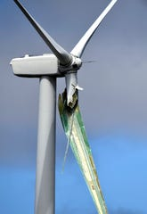 A damaged blade hangs from a wind turbine Friday near Nolan. Two damaged wind turbines were observed in the path of Thursday's tornadic thunderstorm.