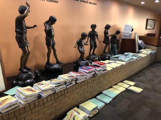 """Statues of children found in the Abilene Independent School District administration office """"guard"""" packets of instructional material that was later distributed to special education students throughout the district on Thursday."""