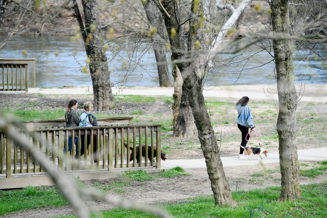Parks along the French Broad River were crowded with people despite the coronavirus pandemic March 19, 2020 in Asheville.