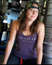 Erin Jordan, an employee at Archetype Brewing, is concerned about making ends meet after the state mandated closures of bars and restaurants except for takeout or delivery.