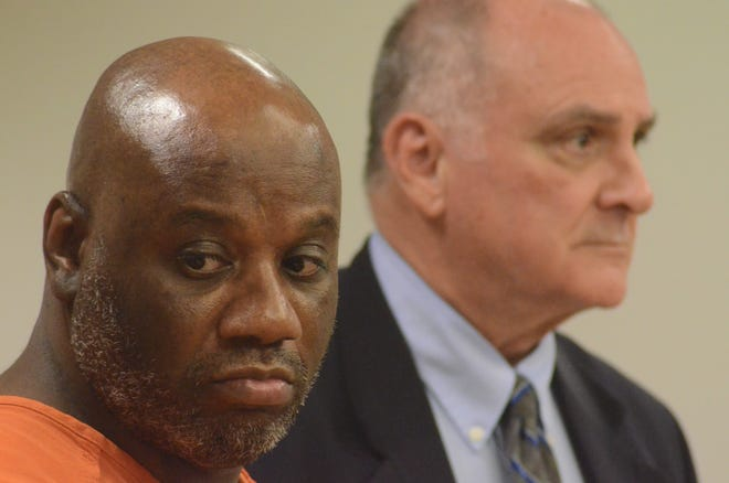 David Johnson with his attorney, John Vincent at Friday's sentencing.
