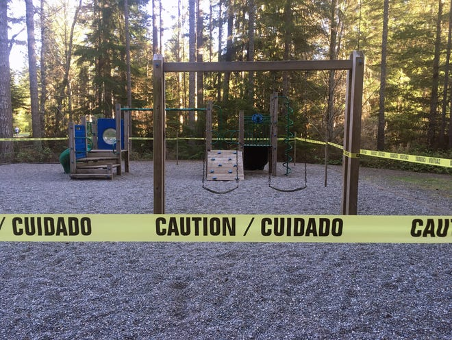 A city playground in Port Orchard is marked with caution tape in March.