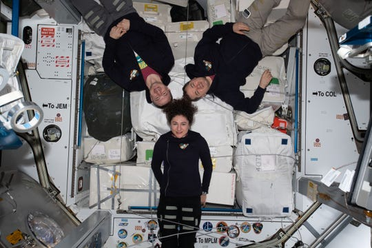 The three-member Expedition 62 crew poses for a portrait inside the Harmony module. Harmony is connected to three International Space Station laboratory modules -- Europe's Columbus, Japan's Kibo and the United States' Destiny lab modules. Clockwise from bottom are, NASA astronauts Jessica Meir and Andrew Morgan and Roscosmos cosmonaut Oleg Skripochka.