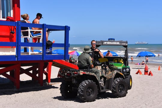 Cocoa Beach police and Brevard County Sheriff's Office deputies used four-wheelers Friday to enforce new $500 fines for drinking alcohol on the beach.