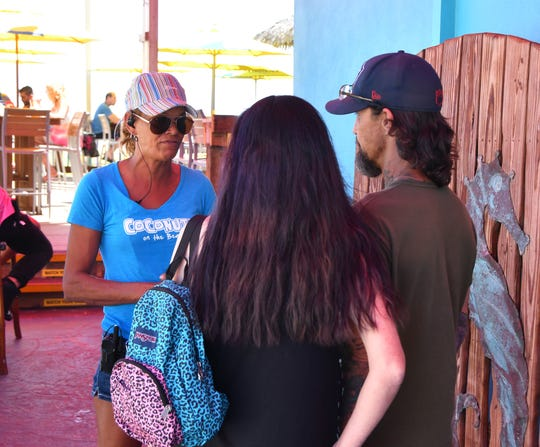 Angela Noble, a manager at Coconuts on the Beach, questioned customers about international travel and the new coronavirus before allowing entry Friday afternoon in Cocoa Beach.