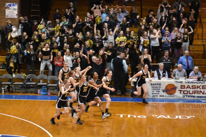 The Harwood girls basketball team celebrates its 47-27 win over North Country in the Division II semifinals last week.