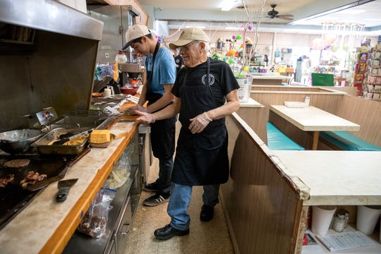 Nick Gomez, left, and Jesse Lerma prepare to-go orders at Hamlin Fountain & Gifts + Bakery on Friday, March 20, 2020. Beginning Saturday, orders can be placed via phone and employees will deliver it to vehicles or customers can pick it up at the front register. The soda fountain has been in business since 1960.