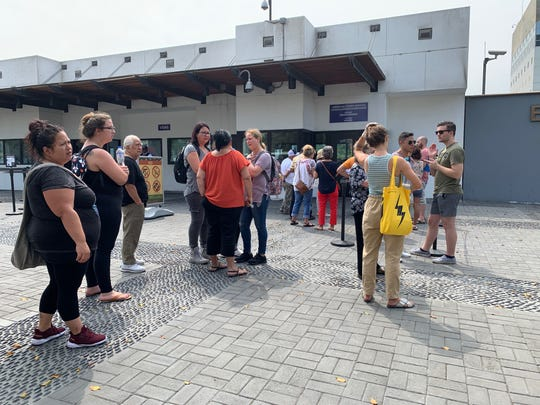 Americans stand in line outside the U.S. Embassy in Lima, Peru in  March 16, 2020, waiting for any information related to travel home to the United States during the COVID-19 coronavirus pandemic.