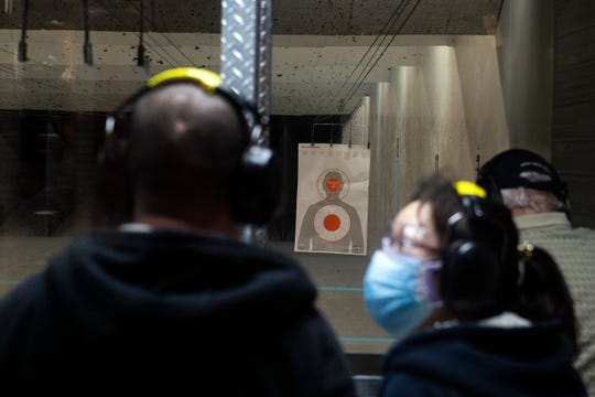 Trainees, who declined to be identified, take a handgun training course inside Bob's Little Gun Shop Friday, March 20, 2020 in Glassboro, N.J.