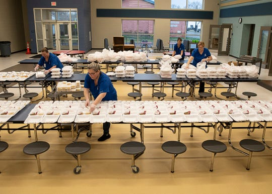 Chillicothe Local Schools food service employers work on filling over 500 trays of food Friday morning to help feed the almost 1000 children who have signed up for food assistance through the school system on Friday, March 20, 2020.