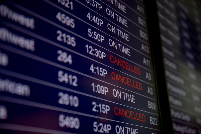 The departure board at at Cincinnati/Northern Kentucky International Airport on Wednesday, March 18, 2020, in Hebron, Ky.