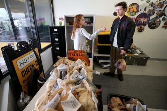 Northern Kentucky University students Lydia Schubarth and Michael Baker, right, pick up donated food, Friday, March 20, 2020, at Northern Kentucky University in Highland Heights, Ky.