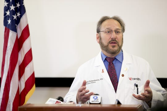 Dr. Carl Fichtenbaum, UC Health infectious disease expert, speaks during a press conference on Thursday, March 19, 2020, in at the Hamilton County Health Department office in Clifton, Ohio, announcing the first case of someone in Hamilton County testing positive for new coronavirus.