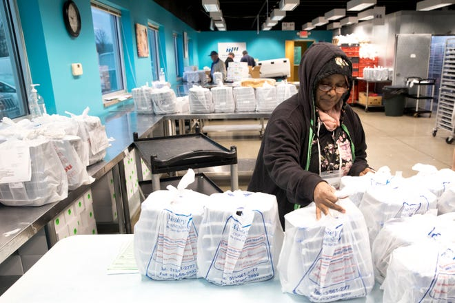 Rahma Ali, a Meals on Wheels driver, prepares her daily deliveries of food to clients at the packaging facility on Wednesday, March 18, 2020 in  Lower Price Hill.