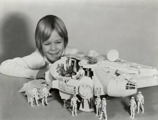 Star Wars Millennium Falcon vehicle playset with Star Wars action figures, stormtroopers, Luke Skywalker, Chewbacca, C-3PO and R2-D2, from Kenner Products.