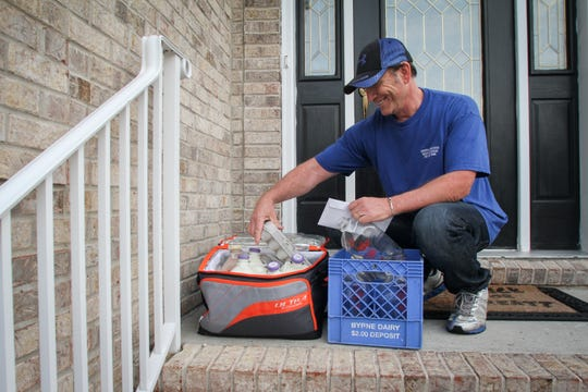 Jeff Milling of Udderly Delicious, an Old Bridge-based glass bottle milk delivery service delivers to a home in Manalapan.