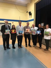 Principal Joe Beltramba, Supervisor of Educational Initiatives Christine Broski, Superintendent Edward Grande, Board of Education President Steve Donkersloot, author Jerry Pallotta, Board of Education member Lorraine Aklonis, and Valley Road School teacher Trish Peitz