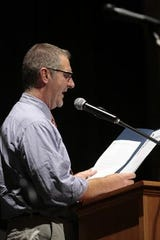 Former Metuchen Councilman Richard Weber delivers a proclamation during a 2009 event at the Forum Theatre.