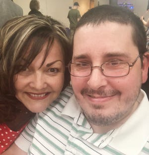Lisa Reed with Adam Steinal at the annual formal dance that RHDD holds annually for their clients. Reed is executive director for the Residential Home for the Developmentally Disabled, Inc in Coshocton.