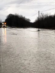Ohio 16 closed covered in water near Conesville on Friday morning.