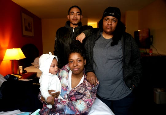 (L to R) Kirmel Neal, 1, his mother India Williams, 20, father Kirmel Neal, 19 and his grandmother Christine McCalebb in their Days Inn hotel room in Warren, Michigan on Thursday, March 19, 2020.Williams, her boyfriend, Kirmel Neal, 19 and her mother Christine McCalebb had to run out of their Detroit home on March 9 when the back of the house caught fire.Lost in the fire were many of their son's clothing, medications and air purifier as he suffers from asthma.Between the fire and the Coronavirus going around the family is dealing the best they can with the situation they are in often moving from hotel to hotel.