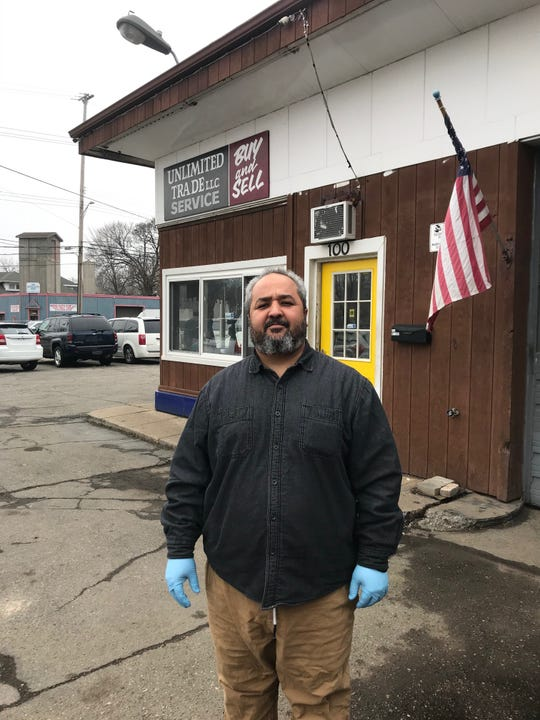 Mohammed Salem says traffic and sales have plummeted at his Lansing used car lot.
