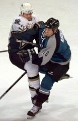 Sharks defenseman Marcus Ragnarsson, right, checks Stars forward Mike Keane during a game in Dallas in 2000.