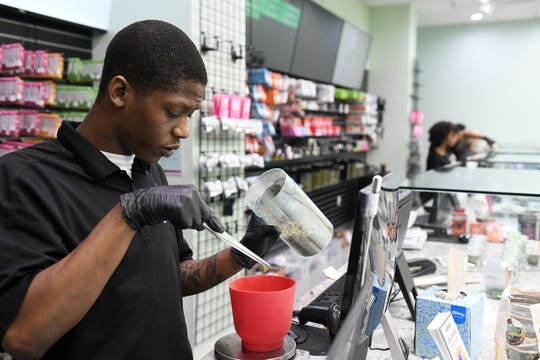 Dispatch manager Duwane Mallett, 25, fills an order of medical marijuana for delivery at Five & Dime cannabis dispensary in Detroit on Mar. 19, 2020. Many people are stocking up on their medical marijuana just like other prescriptions.