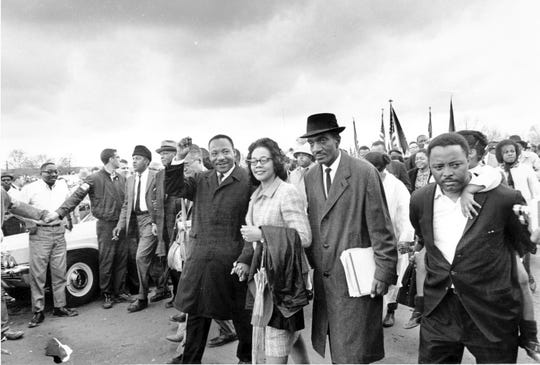 Dr. Martin Luther King Jr., and his wife, Coretta Scott King, lead off the final lap to the state capitol at Montgomery, Ala. on March 25, 1965. Thousands of civil rights marchers joined in the walk to demand voter registration rights for blacks.